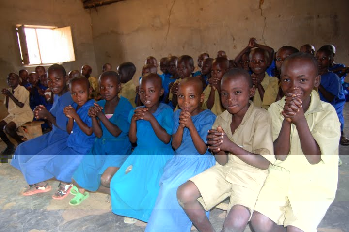 Rwandan schoolchildren excited to receive their deworming medication.  Photo courtesy of The Access Project