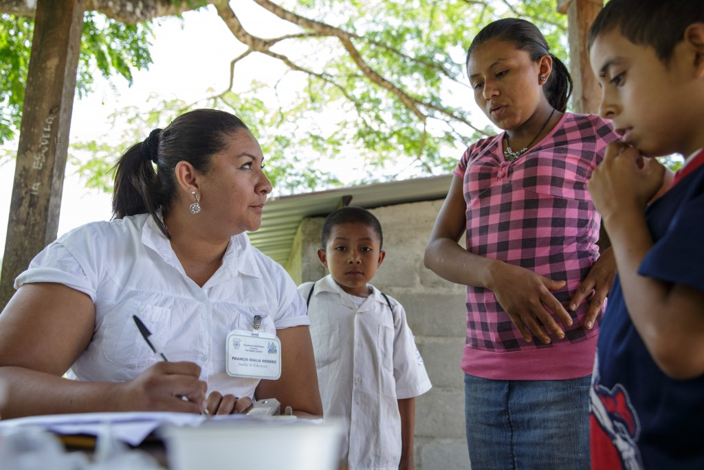 A pregnant woman speaks with a health worker during a vaccination session at the primary school in the town of Coyolito, Honduras on Wednesday April 24, 2013.